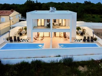 Photo for Brand new modern villa with pool near the beach for 6 + 2 persons