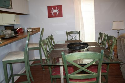 Large dining table and extra seating at the bar