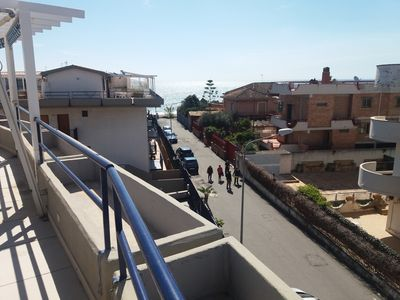 Photo for Seafront apartment sleeps 6 with large terrace and free garage