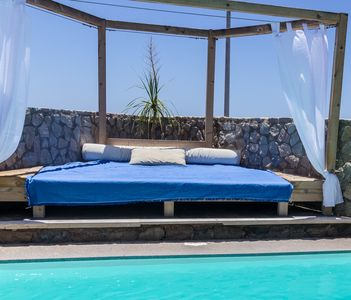 Balinese bed in the swimming pool area
