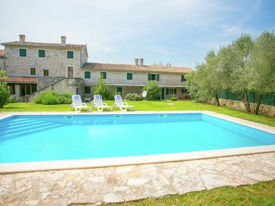 Photo for Beautiful holiday Apartment surrounded with a Stone wall with Pool and Garden