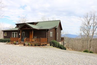 Cabin from the driveway.  Outdoor seating in multiple areas and fire pit.