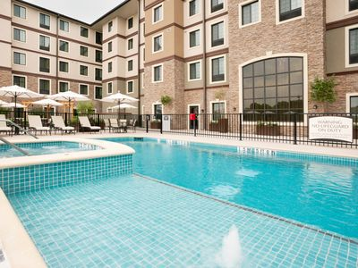 Photo for Outdoor Pool and Hot Tub + Free Breakfast   Premium Suite Only 15 Minutes from Six Flags!