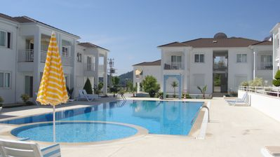 Photo for Modern apartment with pool and garden