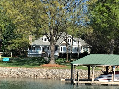 Photo for Gorgeous Lakefront home with a private dock & the most beautiful sunset views!