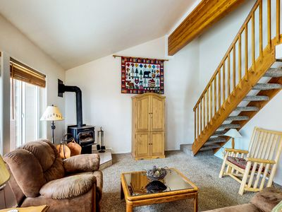 Photo for Cozy condo w/ a wood stove, shared hot tub, pools, & tennis - close to downtown!