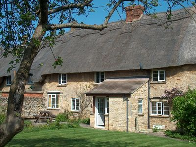 Photo for A Typical Cotswold Stone And Thatched Cottage With A Large Enclosed Garden
