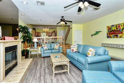 Spacious living room with large flat panel HDTV, fireplace