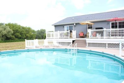 Large pool with safety gate at both entrances (5' depth) and lots of pool toys