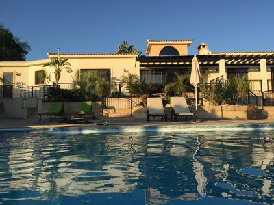 Pool and villa in evening light