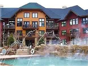 2 heated pools with waterfall, huge hot tub, outdoor fireplace and 2 grills