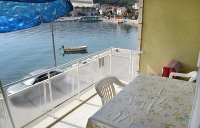 Photo for Two bedroom apartment with terrace and sea view Sumartin, Brač (A-2953-b)