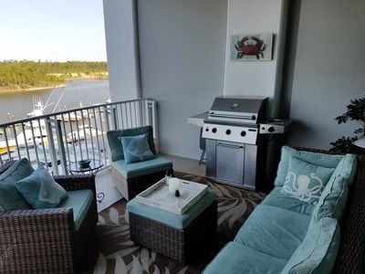 Cozy outdoor patio w/ gas grill. A lovely view of intracoastal waterway & marina