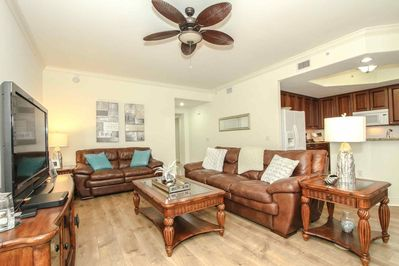 Cozy atmosphere with comfortable seating & large flat screen TV in this 1st floor unit with open floor plan.