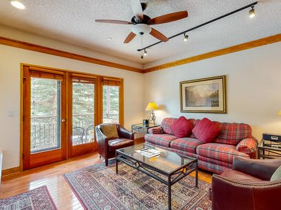 Photo for Ski-in/ski-out mountain condo w/ wood-burning fireplace & shared pool, hot tubs!