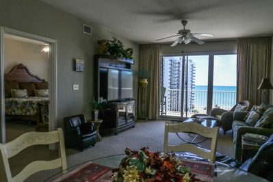 """Spacious living space with a gorgeous view of the gulf and 60"""" smart TV."""