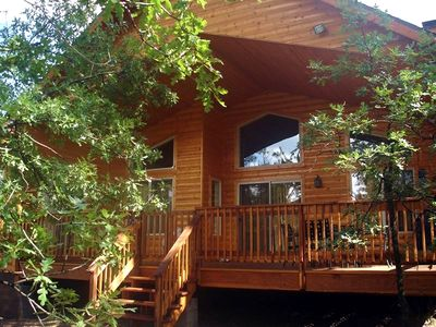 Back Porch of Cabin  Overlooking  Private  Fully Fenced  4000 sq. ft. Play  Area