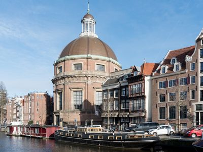 Photo for Historic luxureous houseboat in center of Amsterdam