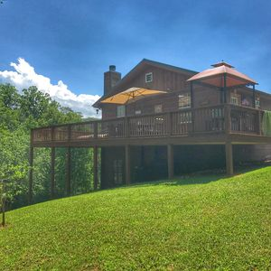 Riverside Retreat has it all!  Mt. View, River, creek, acre, FP, Spa, game room