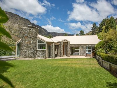 Photo for Alpine retreat with huge open fireplaces and views over the Shotover River