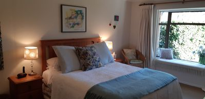Main Bedroom with quality king bed and luxury linen and stunning views