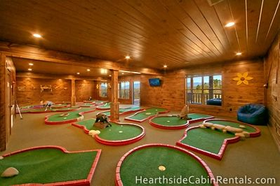 18 hole mini golf course inside Mountain Top Retreat cabin in Pigeon Forge.