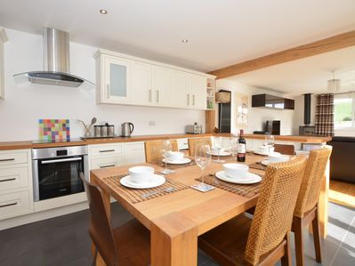 Open plan kitchen/living/dining area perfect for a family dinner