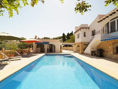Photo for This 4-bedroom villa for up to 9 guests is located in Moraira and has a private swimming pool, air-c