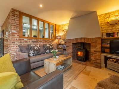 Photo for A traditional brick and flint Grade II listed cottage in Great Walsingham.