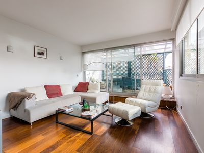 Photo for Bright 1BR apartment near botanic gardens of Bois de Boulogne, by Veeve