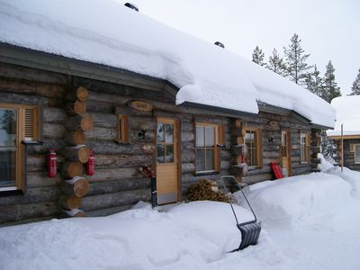 The cabin under its cozy blanket of snow