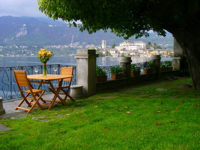 Photo for Apartment in villa with garden in the historic center of Orta San Giulio