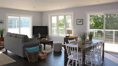 Open concept living room & dining room. Two patio doors take you to the deck.
