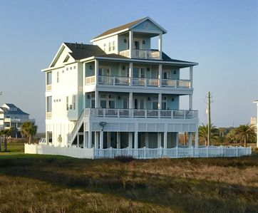 View of House from the beach.  All three decks overlook the ocean!