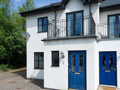 Photo for This modern house sits in a super position in Abersoch's boatyard, very close to the harbour beach a