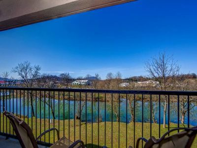 Photo for Riverfront condo w/ shared pool & hot tub - close to Pigeon Forge attractions!