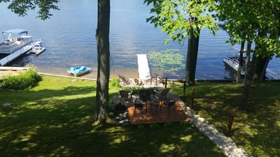 View of mid yard deck, third small deck by water and paddleboat for our guests.