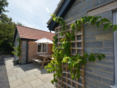 Enter this property past the stunning vines