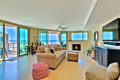Living room with 2 sliding patio doors that provide lots of ocean breeze