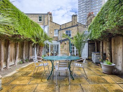 Photo for Lovely 2 Bed Garden Flat w/ Stunning Patio