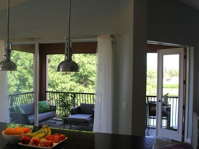 Great open kitchen with sliding wall opens to the breezy lanai.