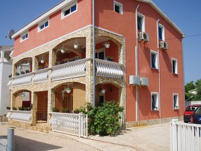 Photo for Holiday apartment with air conditioning only 200 meters from the beach