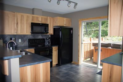 Kitchen with private hot tub & BBQ on the back deck