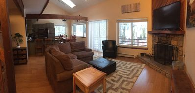 Open floor plan with balcony access to amazing mountain views