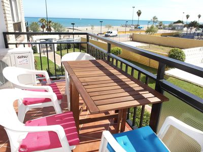 Photo for BEACHFRONT, Magnificent large pool,& gardens. South west facing sunny balcony.