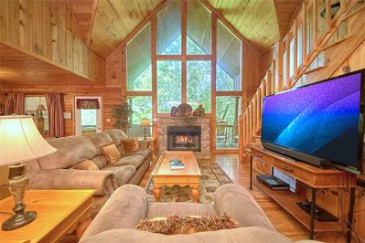 Now, that's a great room! - With a towering vaulted ceiling, plush seating, a fireplace, and large windows that provide a spectacular view of the lush woodlands, Good Times' great room is worthy of the name.
