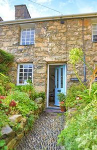 Photo for Character double-fronted stone cottage within walking distance of Nefyn beach
