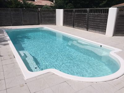 Photo for Gite with 2 bedrooms, private patio, quiet and private parking, heated pool