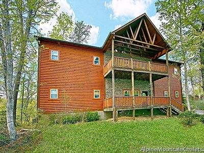 Photo for River Song Retreat is a lofty cabin of stone and wood located near Gatlinburg.