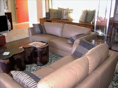 Cozy, comfy new leather sofas; the red door the is back entry from driveway
